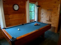 Smoky Mountain log cabin rental with a pool table.