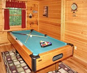 Smoky Mountain Log Cabin with a Pool Table.
